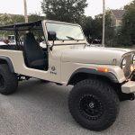 Overbuilt Customs tan Jeep